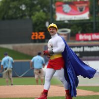 employee having fun at Iron Pigs Game